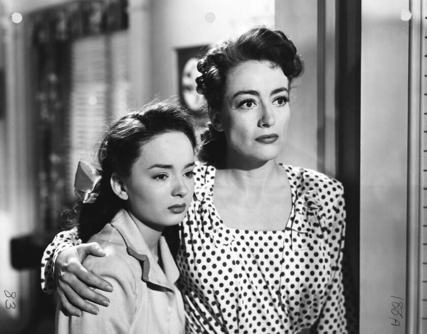 "Ann Blyth and Joan Crawford in ""Mildred Pierce."""