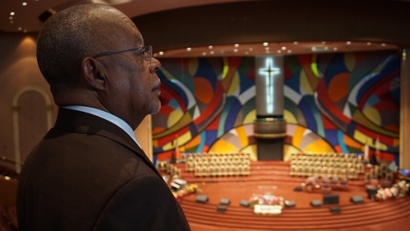 Henry Louis Gates Jr., admires the mural at Church of God In Christ West Angeles.