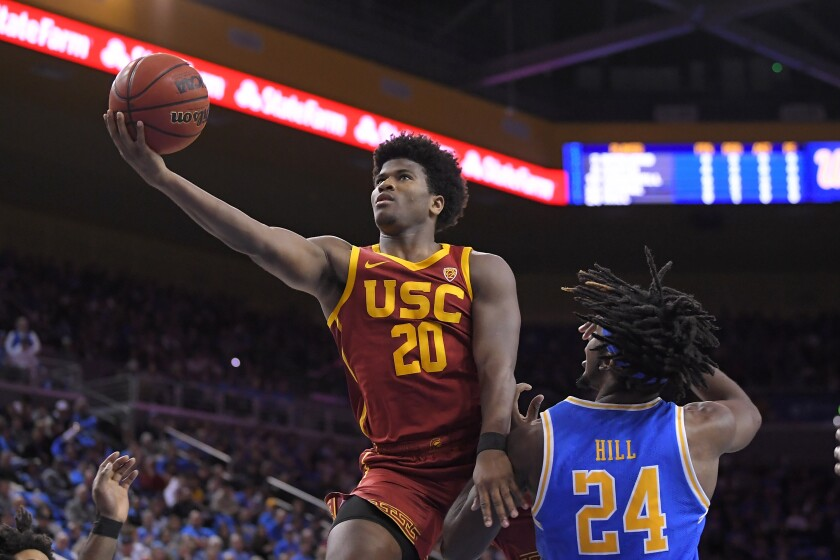 USC guard Ethan Anderson, left, shoots as UCLA forward Jalen Hill defends during the first half on Jan. 11 at Pauley Pavilion.