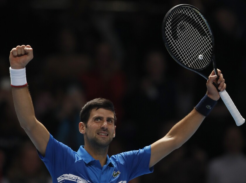 Serbia's Novak Djokovic celebrates after defeating Italy's Matteo Berrettini in their ATP World Tour Finals singles tennis match at the O2 Arena in London, Sunday, Nov. 10, 2019. (AP Photo/Alastair Grant)