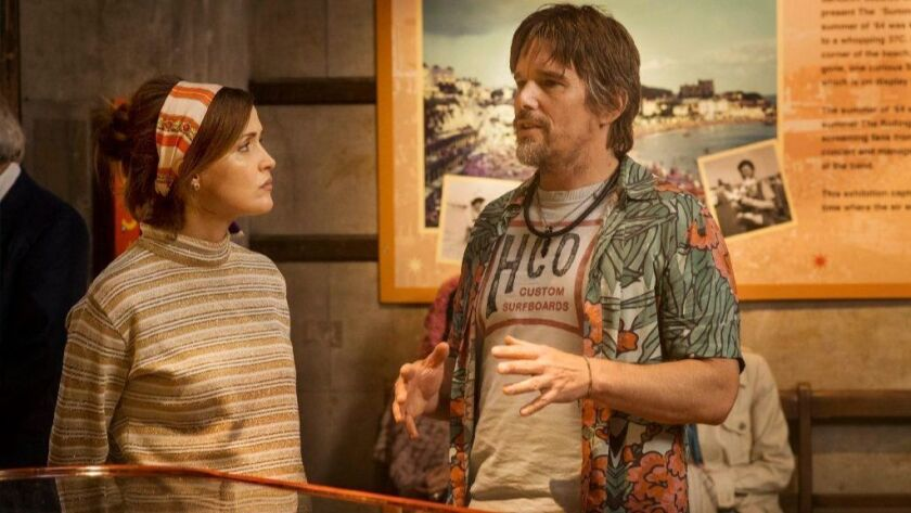 "Ethan Hawke, right, and Rose Byrne in a scene from the movie ""Juliet, Naked."""