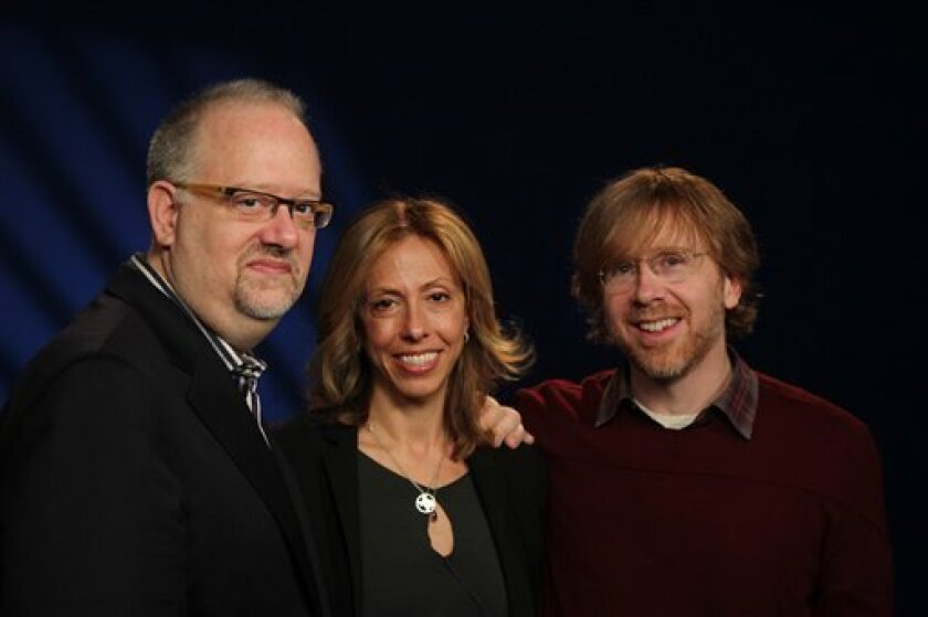 "In this Monday,March 11, 2013, photo, from left, playwright Doug Wright, lyricist Amanda Green and Phish founder Trey Anastasio pose for a portrait in New York. The trio have teamed up to create the new Broadway musical ""Hands on a Hardbody."" (AP Photo/John Carucci)"