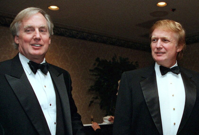 Robert Trump, left, with his brother Donald in 1999.