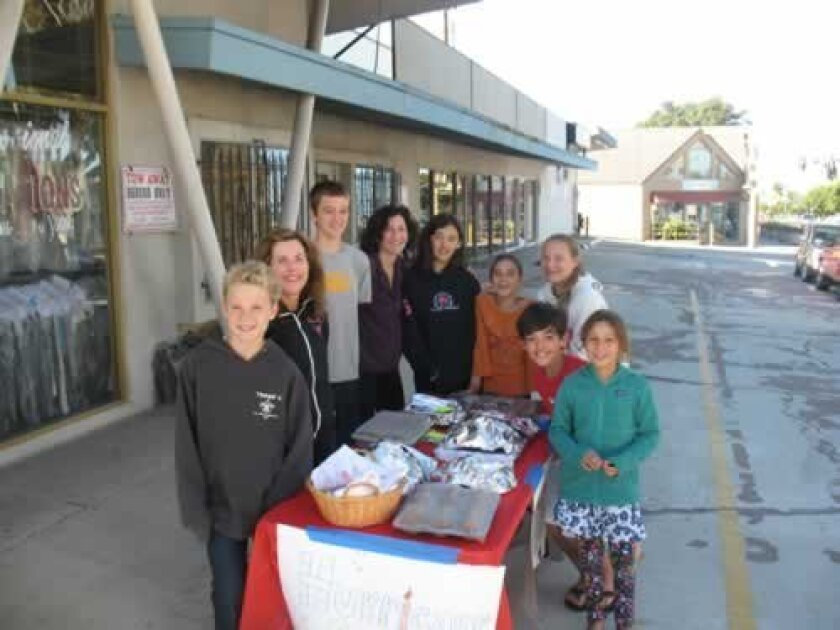 Muirlands Middle school students staff a bake sale to benefit the hoboken Rotary in New Jersey. Courtesy