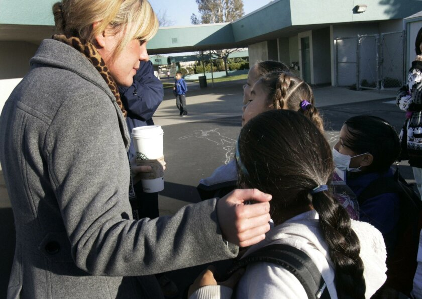 Palmer Way Elementary school second grade teacher Jolene Vermillion was greeted by her students as they headed off to class on Friday morning.