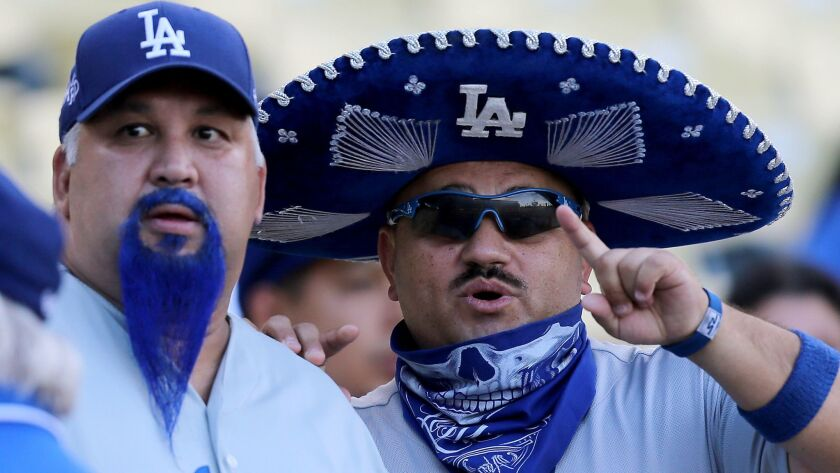 LOS ANGELES, CALIF. - SEP. 1, 2015. Dodgers fans Blue Beard, left, and Mariachi Loco wait for the s