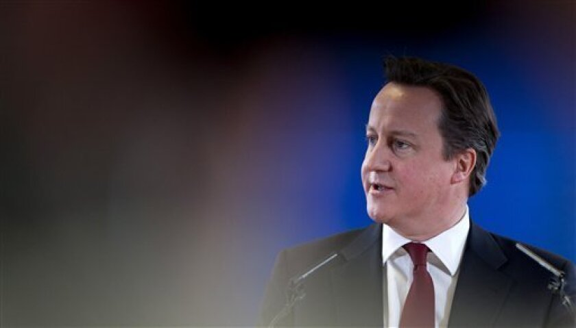 British Prime Minister David Cameron speaks during a media conference at an EU summit in Brussels on Friday, March 15, 2013. On the second anniversary of an uprising that evolved into Syria's brutal civil war, the European Union's national leaders will likely discuss whether to arm rebels trying to