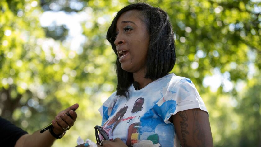 In this July 6, 2017, photo, Diamond Reynolds, the girlfriend of Philando Castile, talks in St. Paul, Minn., about what her life has been like since Castile was fatally shot during a traffic stop a year ago.