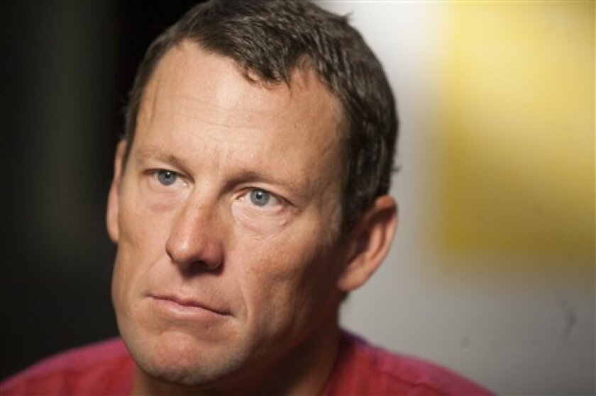 "FILE - This Feb. 15, 2011, file photo shows Lance Armstrong during an interview in Austin, Tx. Attorneys for Armstrong have demanded an on-air apology from ""60 Minutes"" after the head of Switzerland's anti-doping laboratory denied allegations the seven-time Tour de France winner tested positive for performance-enhancing drugs at the 2001 Tour de Suisse. (AP Photo/Thao Nguyen, File)"