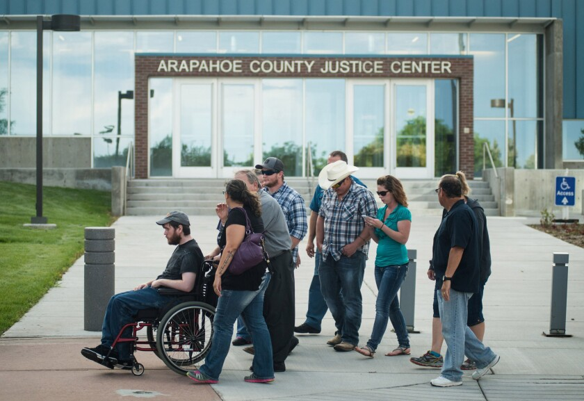 Caleb Medley, a survivor of the Aurora theater massacre, leaves the Arapahoe County Justice Center after James Holmes was convicted on all 165 counts. The verdict came Thursday, nearly three years to the day after Holmes stormed the theater, killing 12 and wounding 70.