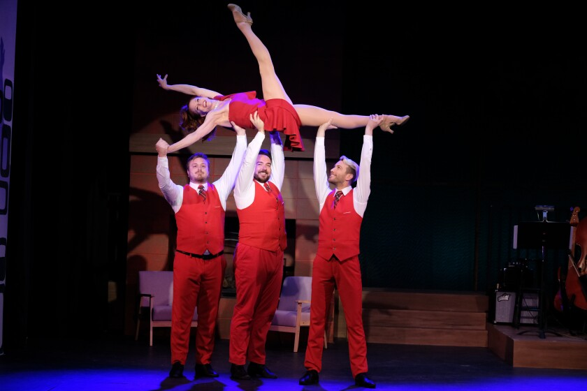 "Dancer Leslie Stevens is held aloft by Jacob Caltrider, left, Luke Harvey Jacobs and Sean Thomas Kiralla in a dance scene from ""Welkome Home for the Holidays!"" at the Welk Resort Theatre in Escondido."
