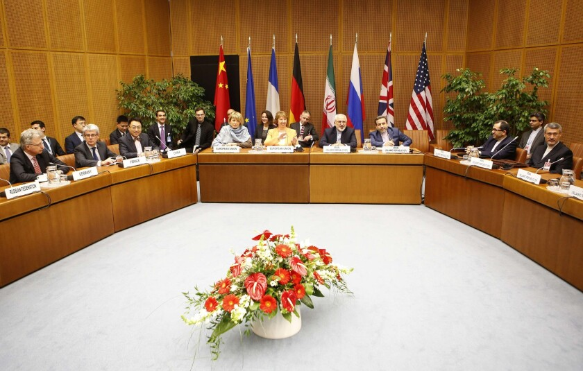 Negotiators from six world powers and Iran, shown here on March 18, have begun a final round of nuclear talks in Vienna.