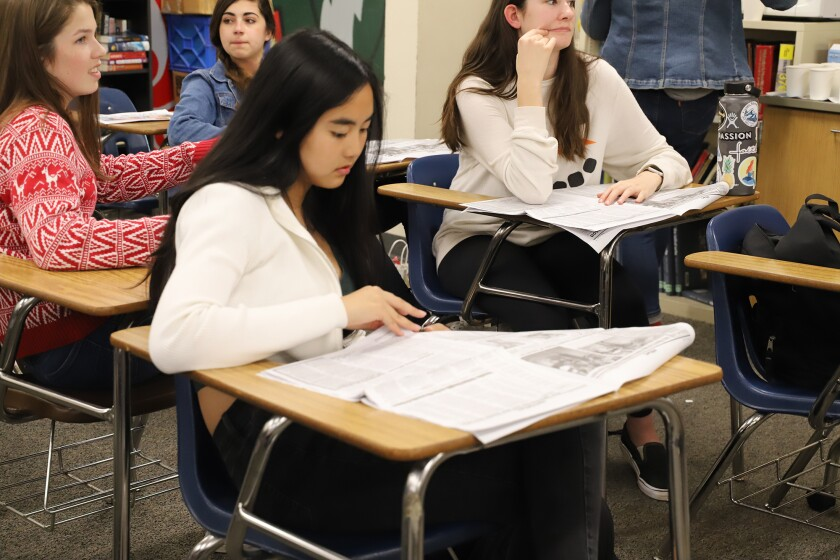 Poway High School student Vy Le peruses The Illiad newspaper during a critique.