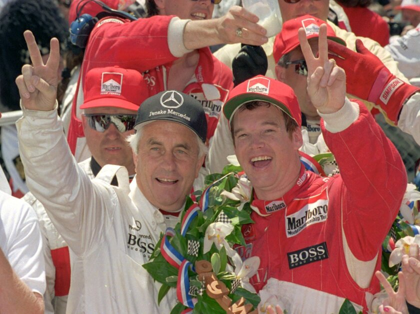 FILE - In this May 29, 1994,  file photo, Indianapolis 500 winner Al Unser Jr., right, celebrates with car owner Roger Penske after winning the 78th running of the race at Indianapolis Motor Speedway in Indianapolis. With all the hoopla surrounding the 100th Indianapolis 500, Roger Penske has a cel