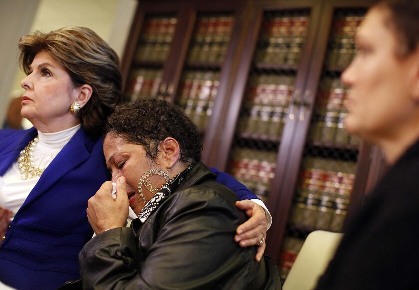 Gloria Allred consoles Chelan (identified only by first name) during a news conference Wednesday. Three victims, Beth Ferrier, Helen Hayes, and Chelan appeared alongside Allred alleging that Bill Cosby attacked them.