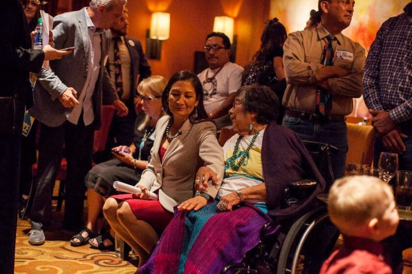 Congresswoman-elect Deb Haaland speaks to her mother Mary Toya following the news of her election during midterms' election night in Albuquerque,
