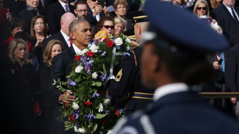 President Barack Obama participates in a wreath-laying ceremony at the Tomb of the Unknowns at Arlington National Cemetery on Nov. 11, 2016.