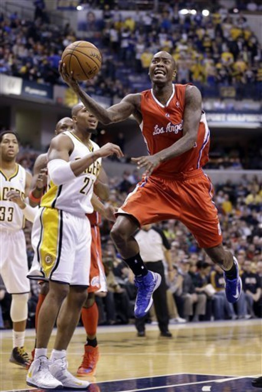 Los Angeles Clippers guard Jamal Crawford  shoots in front of Indiana Pacers forward David West after being fouled during the first half of an NBA basketball game in Indianapolis, Thursday, Feb. 28, 2013. (AP Photo/Michael Conroy)