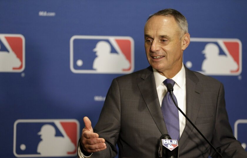 FILE - In this Jan. 21, 2016, file photo, Major League Baseball commissioner Rob Manfred speaks during a news conference at a meeting of MLB owners, in Coral Gables, Fla. On the anniversary of becoming baseball commissioner, Rob Manfred speaks with the AP and says it is possible the strike zone might be raised to the top of the knees. (AP Photo/Lynne Sladky, File)