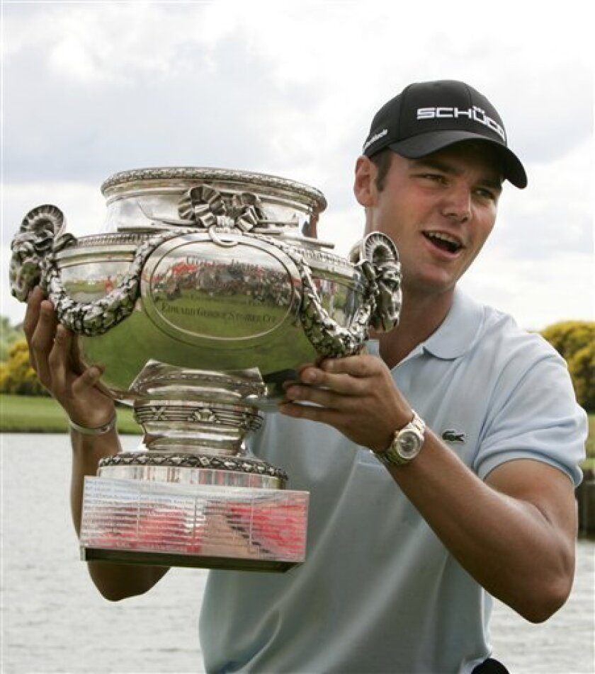 Martin Kaymer of Germany raises the cup after winning the French Golf Open at the Golf National of Saint Quentin en Yvelines, west of Paris, Sunday, July 5, 2009. (AP Photo/Francois Mori)