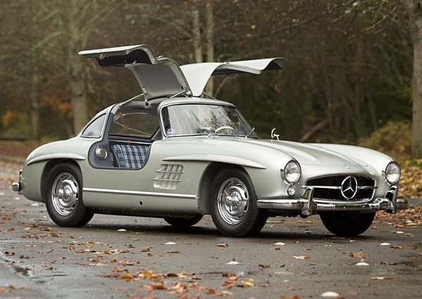 """This 1955 Mercedes-Benz 300 SL Alloy Gullwing sold at a Gooding & Co. auction in Scottsdale, Ariz., for just over $4.6 million in January. It is a metallic silver gray coupe with a six-cylinder inline engine that produces 240 horsepower, about the same as a modern day BMW 328. Road and Track at the time called this coveted Gullwing """"the ultimate in an all-around sports car."""" It spent most of its life in Southern California and was restored in 2011. Interestingly, it has blue plaid seats."""