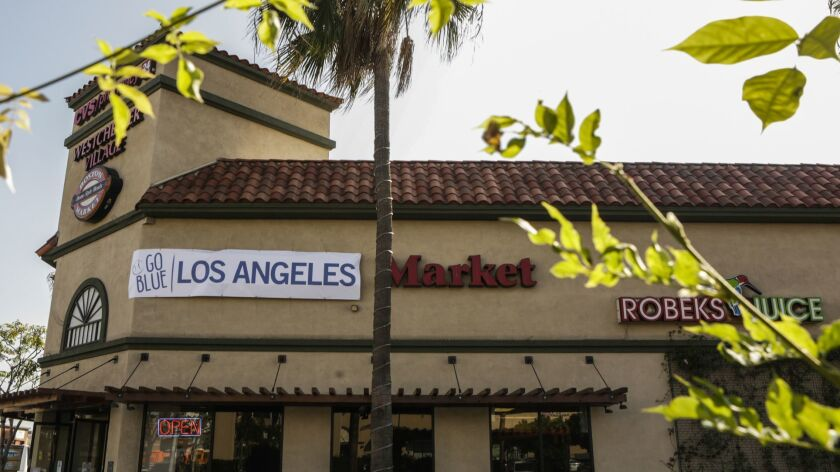 """Ten Southern California Boston Market restaurants have hung banners with the words """"Los Angeles"""" covering """"Boston"""" in the restaurant's name while the Dodgers are playing the Red Sox in the World Series."""