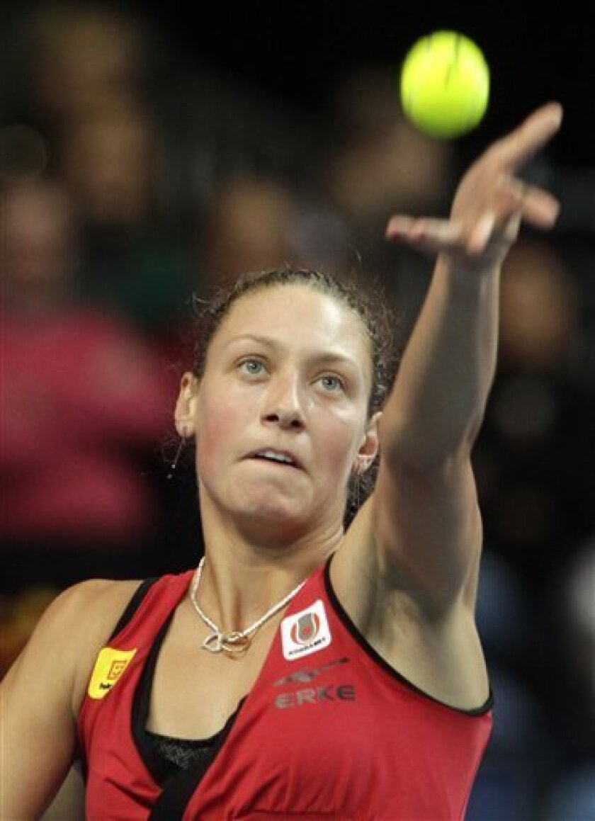 Belgium's Yanina Wickmayer serves the ball to US player Bethanie Mattek-Sands, during the World Group Fed Cup match in Antwerp, Belgium, Saturday, Feb. 5, 2011. (AP Photo/Yves Logghe)