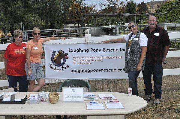 Volunteers Joan Taylor, Maren Christensen, Kathleen and Mitch Farris