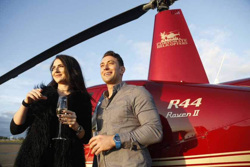 Blind daters Zlata Sushchik, left, and Scott Schindler prepare to take flight on the Romance Tours provided by Corporate Helicopters. Having never been on a helicopter, Zlata was a little concerned with getting motion sickness but she was fine the entire