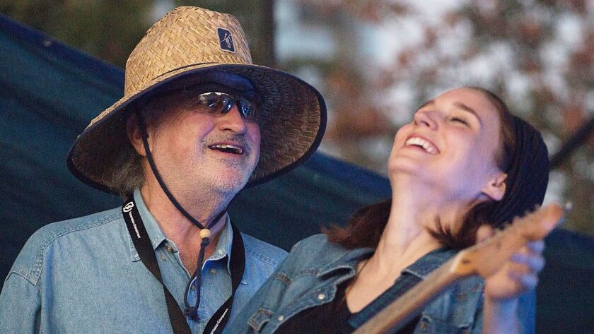 """The elusive Terrence Malick is seen at the 2012 Fun Fun Fun Fest with actress Rooney Mara filming one of many scenes at Austin music events for the movie that eventually would become """"Song to Song."""""""