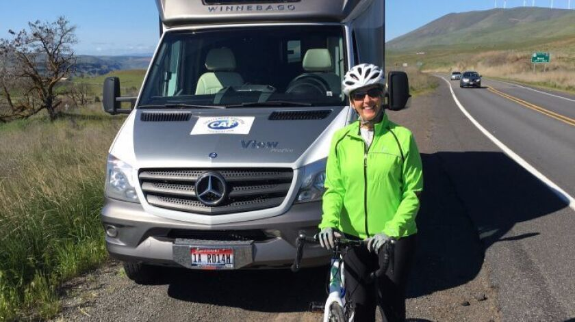 Amy Geppert and the motor home she and husband, Bill, are using on their cross-country cycling trip.