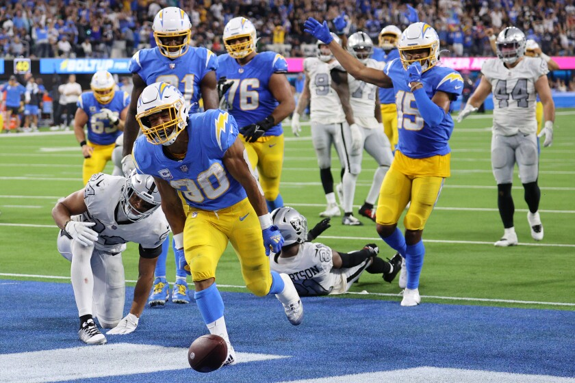 Running back Austin Ekeler (30) of the Los Angeles Chargers celebrates his touchdown against the Las Vegas Raiders.