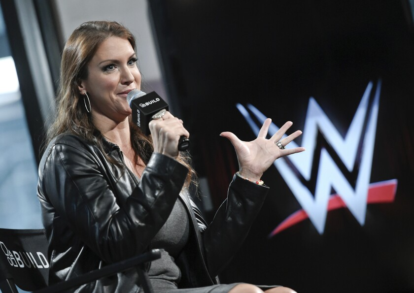 """FILE - In this Friday, Oct. 16, 2015, file photo, American businesswoman Stephanie McMahon participates in AOL's BUILD Speaker Series at AOL Studios in New York. World Wrestling Entertainment is used to making headlines this time of year leading up to WrestleMania. But the company has more on its plate leading up to its showcase event on April 10 and 11, 2021. """"Bringing back fans was needed, and we've been able to try things out that we have thought about but not had the chance,"""" WWE chief brand officer McMahon said. (Photo by Evan Agostini/Invision/AP, File)"""
