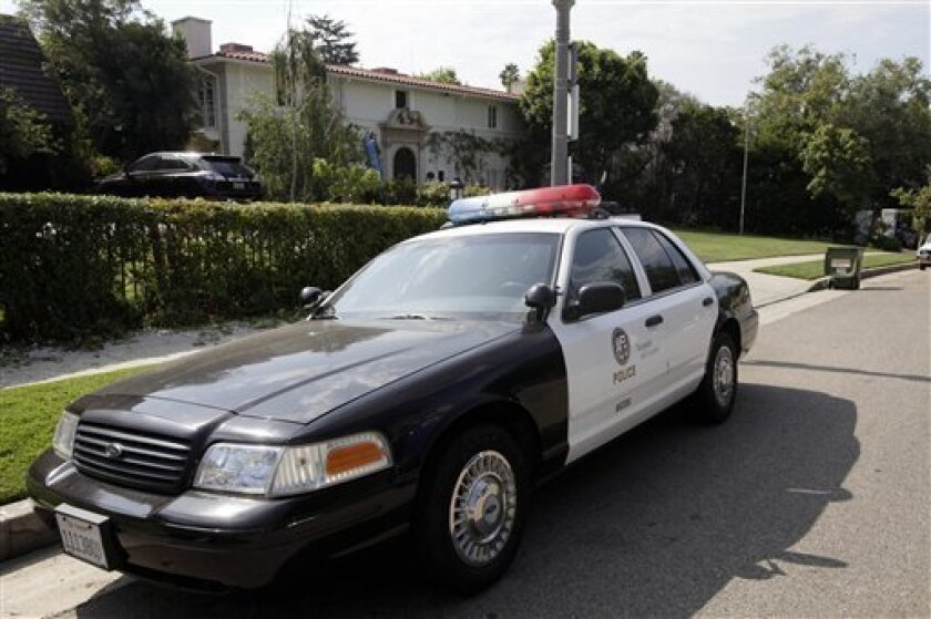 A Los Angeles police patrol car is shown near the residence of the British Consul general Thursday July 7, 2011, the site where the Duke and Duchess of Cambridge will take up temporary residence during their visit to Southern California beginning Friday in Los Angeles. Security around the British Consul residence has been heightened to ward off curious onlookers and photographers during the royal visit. (AP Photo/Nick Ut)