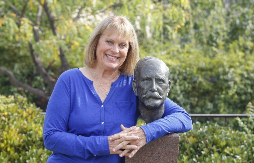 Author Sandra Bonura is shown with the bust of John D. Spreckels at the Spreckels Organ Pavilion at Balboa Park.