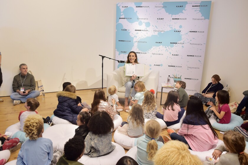 Elizabeth Chambers reads to children at the museum event.