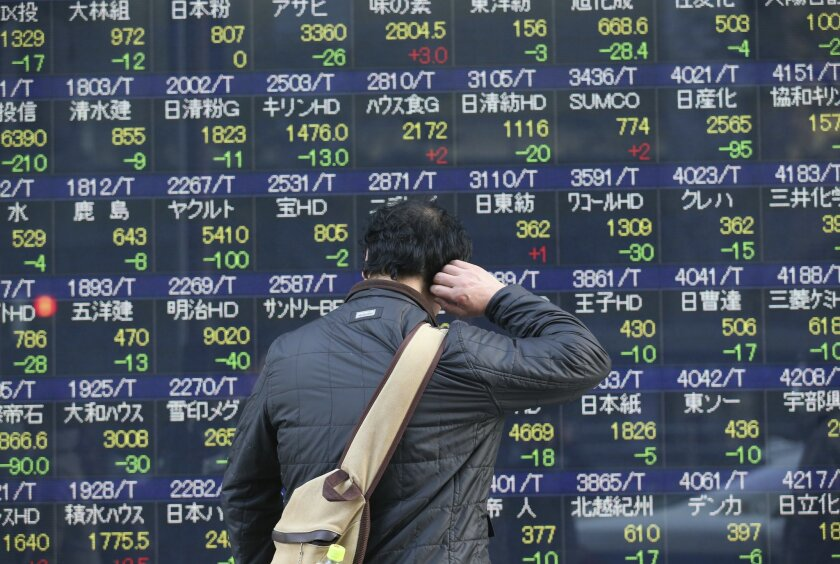 A man looks at an electronic stock board of a securities firm in Tokyo, Friday, Feb. 19, 2016. Asian stock markets slipped Friday on lingering concerns about the slump in oil prices and uncertain prospects for the global economy. (AP Photo/Koji Sasahara)