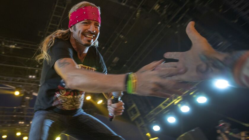 INDIO, CALIF. -- FRIDAY, APRIL 26, 2019: Rocker Bret Michaels greets a fan as he performs on the Pal