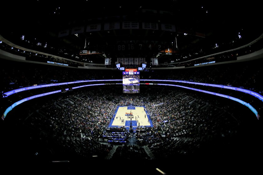 Fans watch a game between the Philadelphia 76ers and Detroit Pistons on March 11, 2020, in Philadelphia.