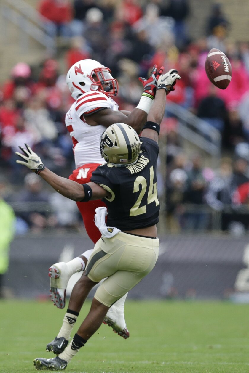 Purdue cornerback Frankie Williams (24) breaks up a pass to Nebraska wide receiver De'Mornay Pierson-El (15) during the first half of an NCAA college football game in West Lafayette, Ind., Saturday, Oct. 31, 2015. (AP Photo/Michael Conroy)