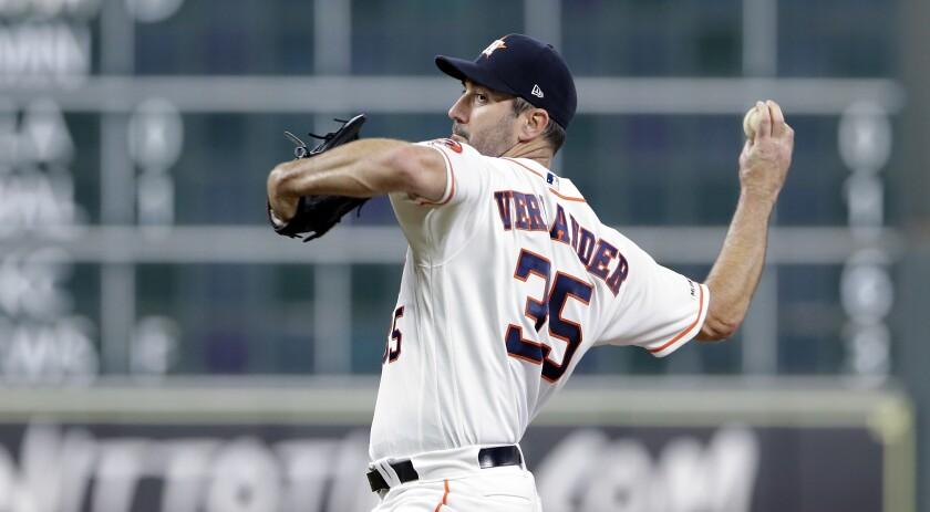 Houston Astros starting pitcher Justin Verlander delivers against the Oakland Athletics on Sept. 12.