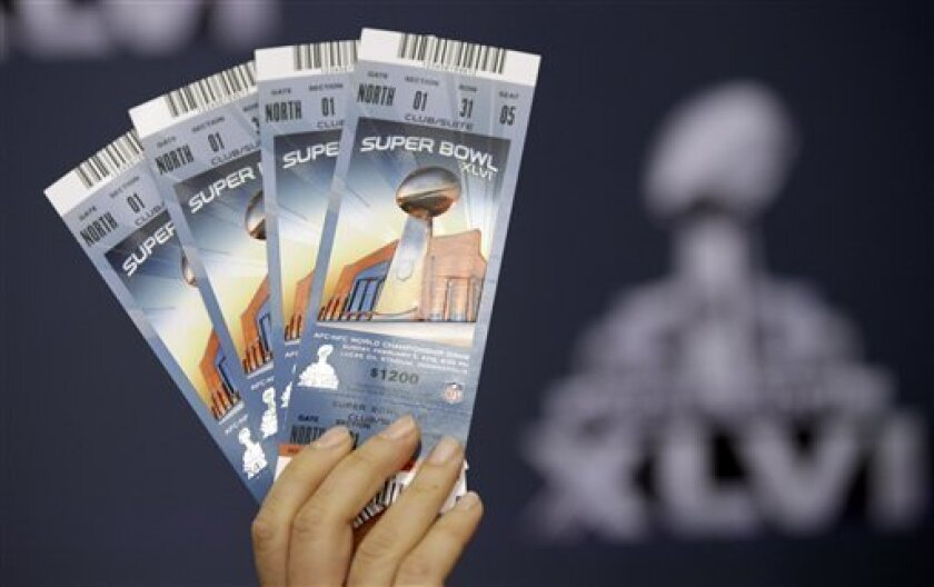 Anastasia Danias, NFL vice president for legal affairs, holds up examples of legal Super Bowl XLVI tickets during a security news conference Thursday, Feb. 2, 2012, in Indianapolis. The New England Patriots will face the New York Giants in Super Bowl XLVI Feb. 5. (AP Photo/David J. Phillip)