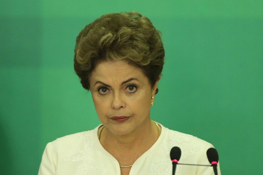 Brazilian President Dilma Rousseff appears at a news conference in Brasilia, the capital, after impeachment proceedings were opened against her.