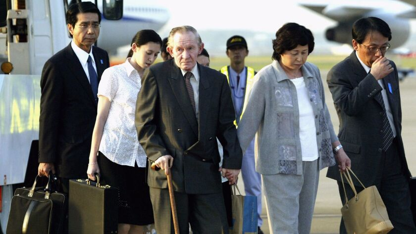 Charles Robert Jenkins and his wife, Hitomi Soga, arrive in Tokyo on July 18, 2004. They were forced