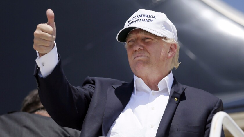 Donald Trump boards his campaign plane in Laredo, Tex., in July 2015, marking the debut of his campaign hat.