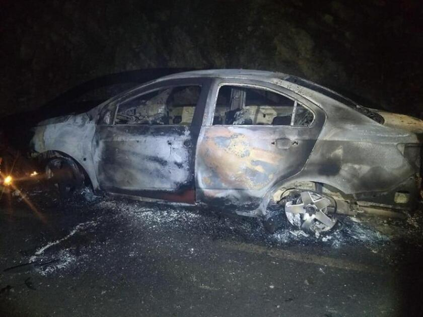 General view of one of the vehicles burned at the site where six alleged criminals were lynched by inhabitants of the municipality of Soledad Atzompa, in the eastern state of Veracruz, Mexico, local authorities reported on Feb. 22, 2019. EPA-EFE / FGE / ONLY EDITORIAL USE / No sales