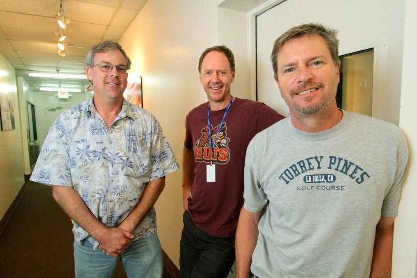 """The main members of JackFM 100.7's new morning radio team, left to right: Chris Boyer, Cookie """"Chainsaw"""" Randolph, and Dave Rickards."""