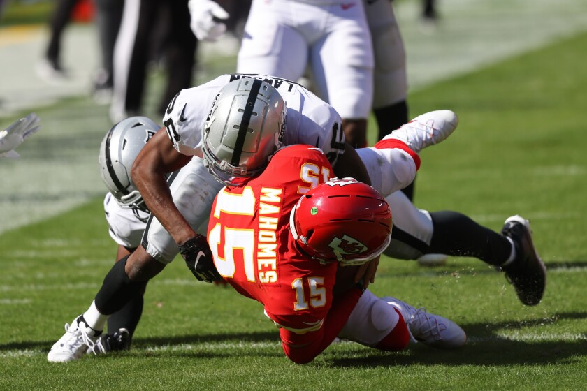 Patrick Mahomes of the Kansas City Chiefs is tackled by Nevin Lawson of the Las Vegas Raiders during Oct. 11 game.