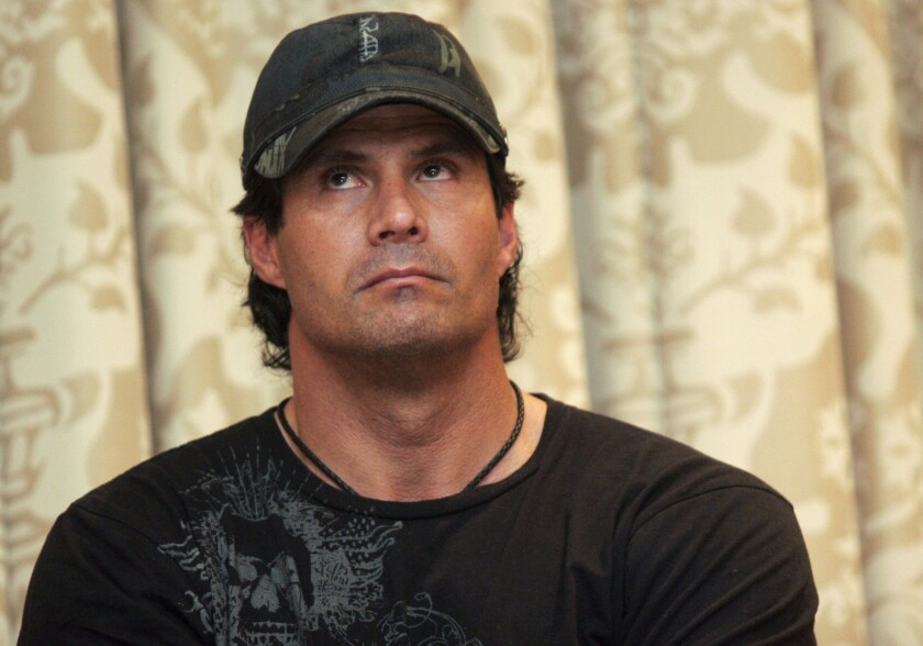 Former baseball player Jose Canseco is undergoing surgery after shooting his finger in his Las Vegas home.