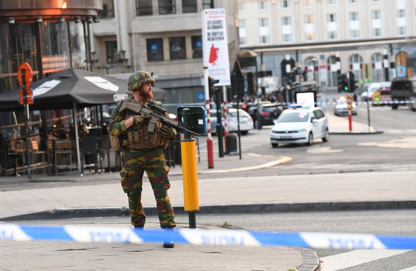 A soldier cordons off an area outside Gare Central in Brussels on June 20, 2017.